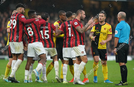 Stock Picture of Steve Cook of Bournemouth and Daryl Janmaat of Watford  argue with referee Mike Dean as the other players push and shove