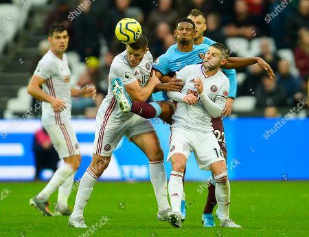 Jack O'Connell and Oliver Norwood of Sheffield United battle with Sebastien Haller of West Ham United