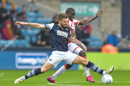 Tom Bradshaw of Millwall under pressure from Badou Ndiaye of Stoke City