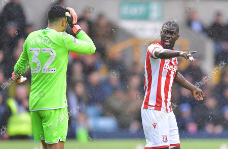 Badou Ndiaye of Stoke City talks to Stoke City goalkeeper Adam Federici
