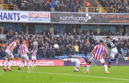 Ben Thompson of Millwall scoring (1-0)