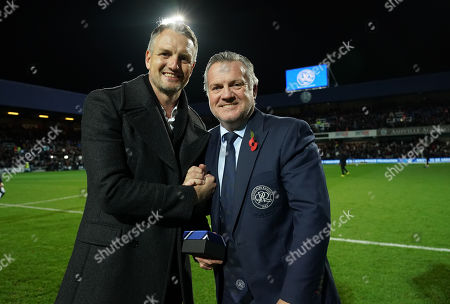 Former QPR player Clint Hill with Andy Sinton on the pitch at halftime after being inducted to the Forever R's club