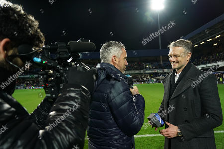 Former QPR player Clint Hill interviewed on the pitch at halftime after being inducted to the Forever R's club