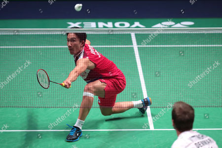 Kento Momota (L) of Japan  in action during his Men's second round match againstHans-Khristian Solberg Vittinghus (R) of Denmark at the Yonex Badminton French Open tournament in Paris, France, 24 Otober 2019.