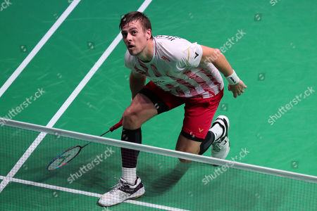 Hans-Kristian Solberg Vittinghus of Denmark in action against Kento Momota (unseen) of Japan during their Men's second round match at the Yonex Badminton French Open tournament in Paris, France, 24 Otober 2019.
