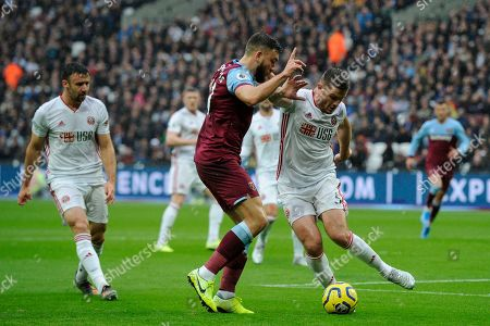 Robert Snodgrass of West Ham United and Jack O'Connell of Sheffield United in action during the Premier League match between West Ham United and Sheffield United at the London Stadium in London, UK - 26th October 2019