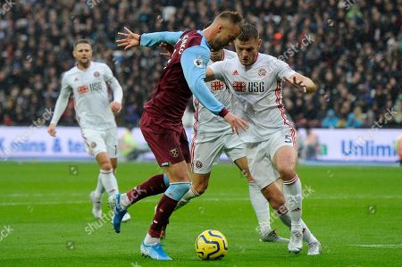 Andriy Yarmolenko of West Ham United and Jack O'Connell of Sheffield United in action during the Premier League match between West Ham United and Sheffield United at the London Stadium in London, UK - 26th October 2019