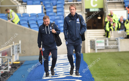 Brighton head coach Graham Potter (right) and Brighton assistant Head Coach Billy Reid arrive at  American Express Community Stadium ahead of the match against Everton today 26th October 2019
