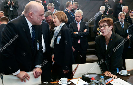 Stock Image of (L-R) Estonian Defense Minister Juri Luik,  French Defense minister Florence Parly, German Defense minister Annegret Kramp Karrenbauer attend the NATO defense ministers meeting at NATO headquarters in Brussels, Belgium,  24 October 2019. NATO defense ministers gather for a two-day meeting to discuss the invasion of northern Syria by alliance member Turkey, amid deep concern over Ankara's actions.