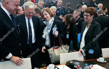 Stock Photo of (L-R) Estonian Defense Minister Juri Luik, Belgium Defense minister Didier Reynders, French Defense minister Florence Parly, German Defense minister Annegret Kramp-Karrenbauer attend the NATO defense ministers meeting at NATO headquarters in Brussels, Belgium,  24 October 2019. NATO defense ministers gather for a two-day meeting to discuss the invasion of northern Syria by alliance member Turkey, amid deep concern over Ankara's actions.