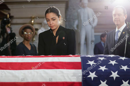 Rep. Alexandria Ocasio-Cortez, D-N.Y., stops to pay her respects at the flag-draped casket of Rep. Elijah Cummings, D-Md., at the US Capitol in Washington, DC, USA, 24 October 2019. Late Maryland Representative Elijah Cummings died on 17 October 2019.