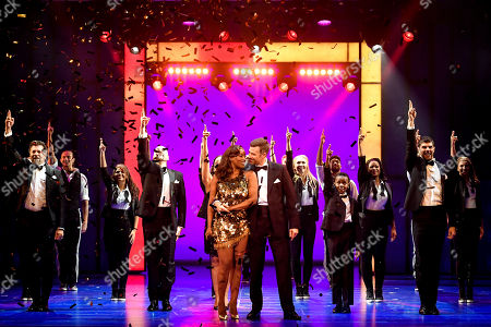 Dutch actress Aisata Blackman (C-L) and German actor Jo Weil (C-R) perform on stage during a photocall of the musical 'Bodyguard' in Cologne, Germany, 24 October 2019. The musical in its German production will go on its first major tour through Germany, Austria and Switzerland starting in October 2019.