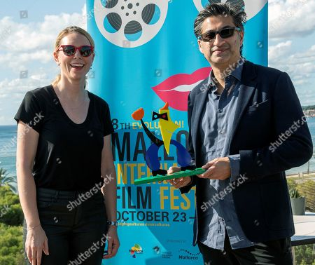Asif Kapadia (R) poses next to Mallorca Evolution! International Film Festival director Sandra Seeling Lipski (L) during a presser after being awarded in the framework of the festival in Palma de Mallorca, Balearic Islands, Spain, 24 October 2019.