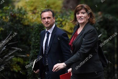 Stock Picture of British Secretary of State for Wales Alun Cairns (L) with Secretary of State for Digital, Culture, Media and Sport Nicky Morgan (R) as they  arrives for a cabinet meeting at 10 Downing Street in London, Britain, 24 October 2019.