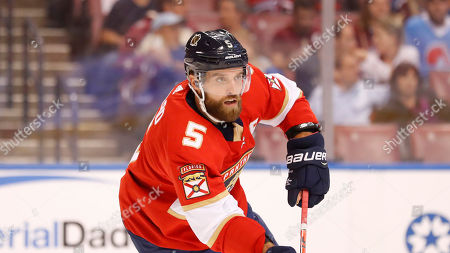 Stock Image of Florida Panthers defenseman Aaron Ekblad looks for an open teammate during the first period of an NHL hockey game against the Colorado Avalanche, in Sunrise, Fla