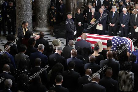 Rep. Emanuel Cleaver (D-MO) gives the invocation next to the flag-draped casket of US Rep. Elijah Cummings (D-MD) as the late congressman lies in state during a memorial service at the Statuary Hall of the US Capitol in Washington, DC, USA, 24 October 2019. Late Maryland Representative Elijah Cummings died on 17 October 2019.