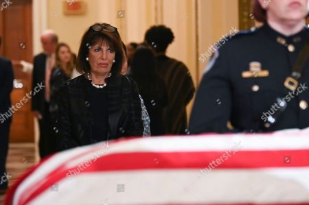 Rep Jackie Speier, D-Calif., pays her respects at the flag-draped casket of Rep. Elija­h Cummi­ngs, D-Md., outside of the House Chamber in the Will Rogers corridor of the U.S. Capitol in Washington