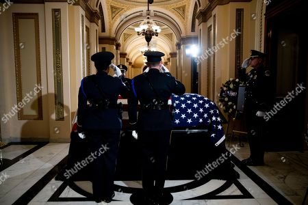 The flag-draped casket of Rep. Elija­h Cummi­ngs, D-Md., lies in state outside of the House Chamber in the Will Rogers corridor of the U.S. Capitol in Washington
