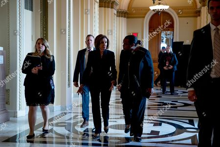 Stock Picture of House Speaker Nancy Pelosi of Calif., arrives to pay respects to Rep. Elija­h Cummi­ngs, D-Md., as Cummings lies in state outside of the House Chamber in the Will Rogers corridor of the U.S. Capitol in Washington