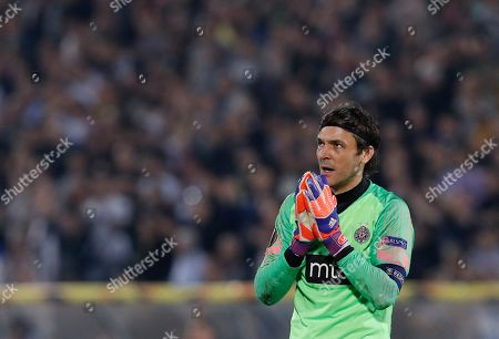 Partizan's goalkeeper Vladimir Stojkovic gestures during the Europa League group L soccer match between Partizan Belgrade and Manchester United at the Partizan stadium in Belgrade, Serbia