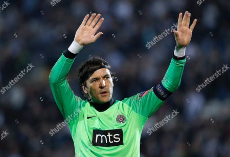 Partizan's goalkeeper Vladimir Stojkovic waves after the Europa League group L soccer match between Partizan Belgrade and Manchester United at the Partizan stadium in Belgrade, Serbia
