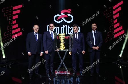 (L-R) President of Italian Federation of Cycling Renato di Rocco, Italian Sport Minister Vincenzo Spatafora, president of Rcs Urbano Cairo, and Milan mayor Giuseppe Sala pose with the trophy during the presentation of the 103rd edition of the Giro d'Italia in Milan, Italy, 24 October 2019. The cycling tour will take place from 09 through 31 May 2020.