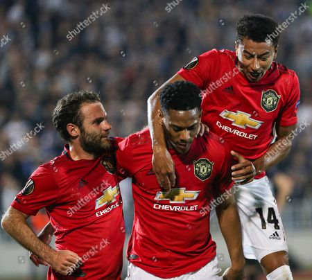 Manchester United's Anthony Martial (C) celebrates with teammates Jesse Lingard (R) and Juan Mata (L) after scoring during the UEFA Europa League group L soccer match between FK Partizan and Manchester United in Belgrade, Serbia, 24 October 2019.