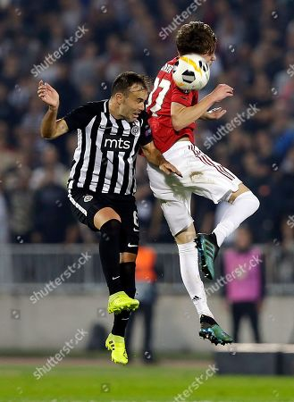 Partizan's Bibras Natcho (L) in action against Manchester United's James Garner (R) during the UEFA Europa League group L soccer match between FK Partizan and Manchester United in Belgrade, Serbia, 24 October 2019.
