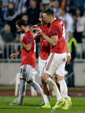 Manchester United's Brandon Williams (C), Juan Mata (L) and Phil Jones (R) celebrate after the UEFA Europa League group L soccer match between FK Partizan and Manchester United in Belgrade, Serbia, 24 October 2019.