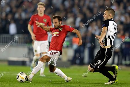 Partizan's Starhinja Pavlovic (R) in action against Manchester United's Juan Mata (L) during the UEFA Europa League group L soccer match between FK Partizan and Manchester United in Belgrade, Serbia, 24 October 2019.