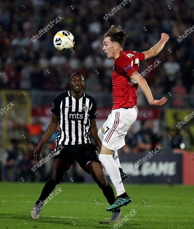 Partizan's Umar Sadiq (L) in action against Manchester United's James Garner (R) during the UEFA Europa League group L soccer match between FK Partizan and Manchester United in Belgrade, Serbia, 24 October 2019.