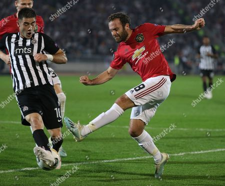 Partizan's Sasa Zdjelar (L) in action against Manchester United's Juan Mata (R) during the UEFA Europa League group L soccer match between FK Partizan and Manchester United in Belgrade, Serbia, 24 October 2019.