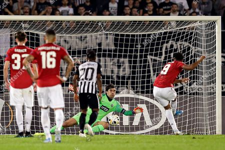 Manchester United's Anthony Martial (R) scores on penalty against Partizan's goalkeeper Vladimir Stojkovic during the UEFA Europa League group L soccer match between FK Partizan and Manchester United in Belgrade, Serbia, 24 October 2019.