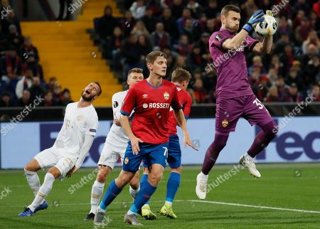Goalkeeper Igor Akinfeev (R) and Ilzat Akhmetov (C) of CSKA Moscow in action against Miha Blazic (L) of Ferencvaros during their UEFA Europa League group H soccer match in Moscow, Russia, 24 October 2019.