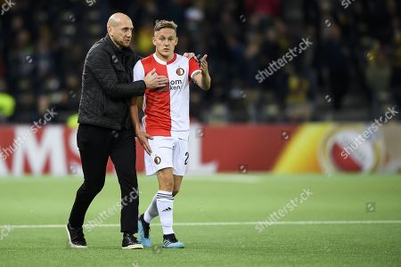 Stock Photo of Feyenoord's head coach Jaap Stam, left, and Feyenoord's Jens Toornstra, right, react during  the UEFA Europa League group stage soccer match between BSC Young Boys Bern and Feyernoord Rotterdam, at the Stade de Suisse in Bern, Switzerland, 24 October 2019.