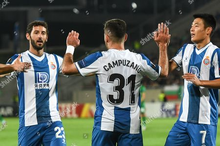 Victor Campuzano of Espanyol (C) celebrates after scoring with his team mates Esteban Granero (L) and Wu Lei (R) during the UEFA Europa League group stage H soccer match between PFC Ludogorets Razgrad and RCD Espanyol in Razgrad, Bulgaria, 24 October 2019.