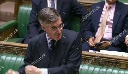 Britain's ruling Conservative Party Leader of the House of Commons Jacob William Rees-Mogg answers a question after giving a statement regarding the offer of a General Election to lawmakers, in London . In a TV interview Thursday Prime Minister Johnson announced that he will offer lawmakers more time to scrutinize his Brexit legislation, but only if parliament agree for a General Election on December 12