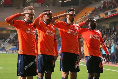 Basaksehir's Irfan Can Kahveci, second right, celebrates after scoring the opening goal with his teammates Basaksehir's Edin Visca, left, Basaksehir's Robinho, Basaksehir's Okechukwu Azubuike, right, during the Europa League Group J soccer match between Istanbul Basaksehir and Wolfsberger AC, at the Fatih Terim stadium in Istanbul, Turkey