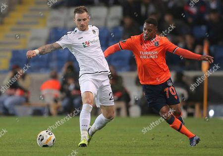 Wolfsberg's Michael Sollbauer, left, and Basaksehir's Robinho fight for the ball during the Europa League Group J soccer match between Istanbul Basaksehir and Wolfsberger AC, at the Fatih Terim stadium in Istanbul, Turkey