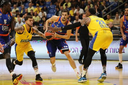 Guillem Vives of Valencia Basket (C) in action against Tarik Black of Maccabi Tel Aviv (R) during the EuroLeague basketball match Valencia Basket vs Maccabi Tel Aviv at Menora Mivtachim Arena in Tel Aviv, Israel, 24 October 2019.