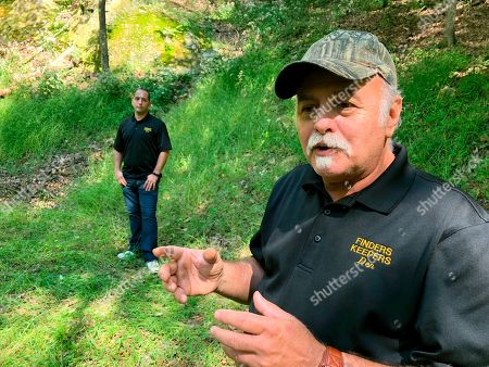 Dennis Parada, right, and his son Kem Parada stand at the site of the FBI's dig for Civil War-era gold in Dents Run, Pennsylvania. The FBI says the excavation came up empty, but the Paradas believe investigators might have found the legendary gold cache