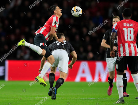 PSV's Erick Gutierrez, left, and LASK's James Holland vie for the ball during the group D Europa League soccer match between PSV and LASK at the Philips stadium in Eindhoven, Netherlands