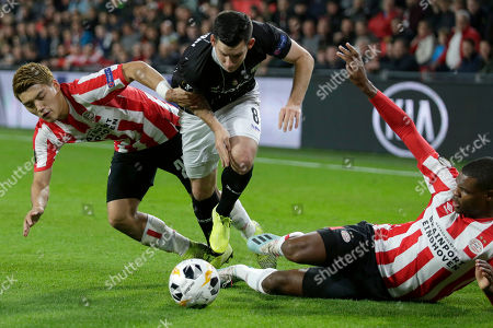 LASK's Peter Michorl breaks through PSV defense with Ritsu Doan, left, and Denzel Dumfries, right, during the group D Europa League soccer match between PSV and LASK at the Philips stadium in Eindhoven, Netherlands