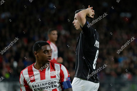LASK's Peter Michorl reacts after missing a chance to score, as PSV's Pablo Rosario is seen in the foreground during the group D Europa League soccer match between PSV and LASK at the Philips stadium in Eindhoven, Netherlands