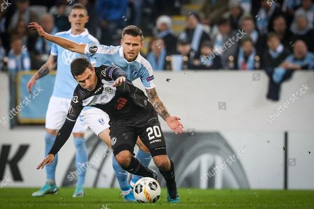 Lugano's Olivier Custodio (front) and Malmo's Arnor Ingvi Traustason in action during the UEFA Europa League group B soccer match between Malmo FF and FC Lugano, in Malmo, Sweden, 24 October 2019.  EPA-EFE/ANDREAS HILLERGREN (CORRECTION)  SWEDEN OUT