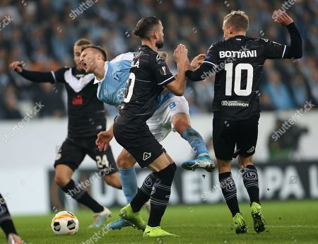 Stock Photo of Lugano's Fabio Daprela (2-R) and Malmo's Arnor Ingvi Traustason (3-R) in action during the UEFA Europa League group B soccer match between Malmo FF and FC Lugano, in Malmo, Sweden, 24 October 2019.
