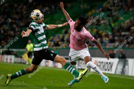 Sporting's Sebastian Coates fouls Rosenborg's Samuel Adegbenro, right, during the Europa League group D soccer match between Sporting CP and Rosenborg at the Alvalade stadium in Lisbon