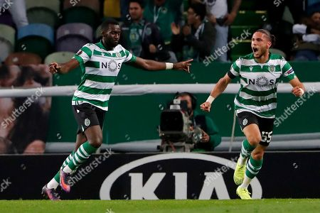 Sporting's Yannick Bolasie, left, celebrates after scoring the opening goal during the Europa League group D soccer match between Sporting CP and Rosenborg at the Alvalade stadium in Lisbon