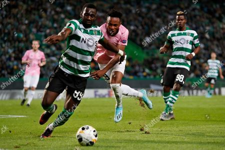 Rosenborg's Samuel Adegbenro fights for the ball with Sporting's Yannick Bolasie, left, during the Europa League group D soccer match between Sporting CP and Rosenborg at the Alvalade stadium in Lisbon