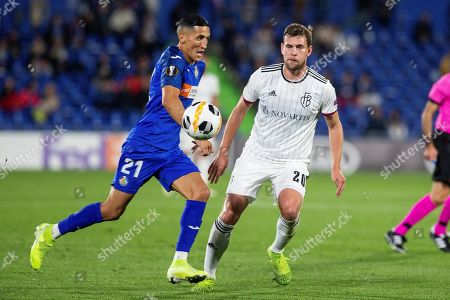 Getafe CF's Faycal Fajr (L) in action against Basel's Fabian Frei during the UEFA Europa League Group C soccer match between Getafe CF and Basel at Coliseum Alfonso Perez stadium in Getafe, Madrid, Spain, 24 October 2019.